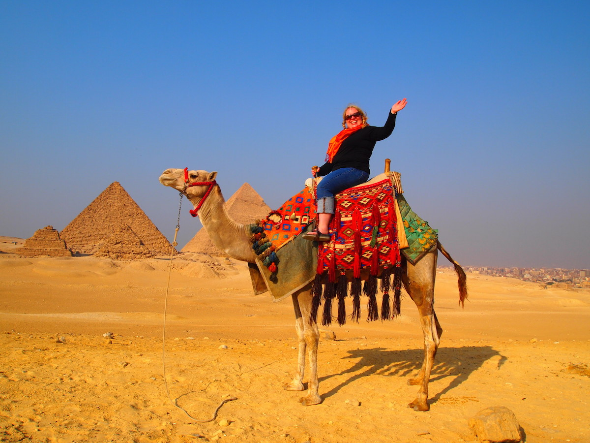 Peg Sewall on a camel in Egypt